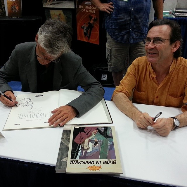 Peeters and Schuiten in the booth of Alaxis Press